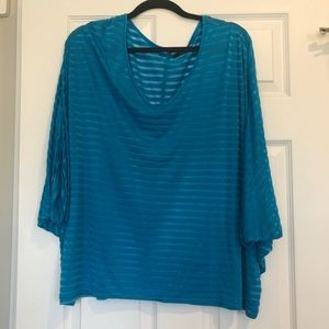 Sheer blue flowy top.